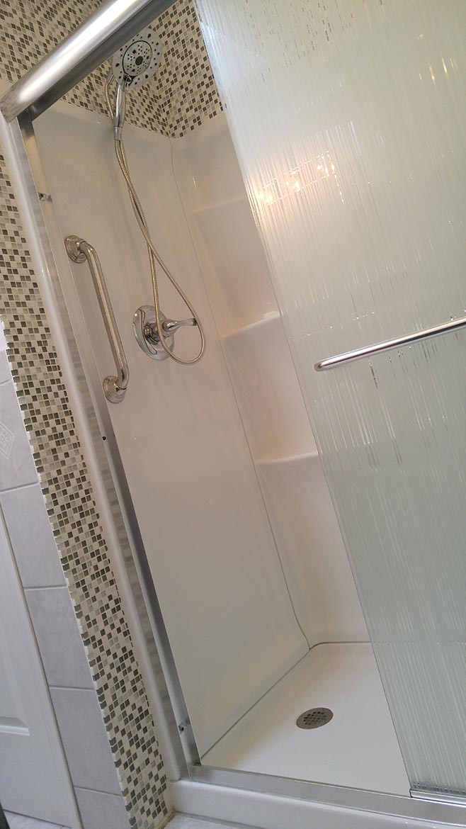 Custom tile added areound shower