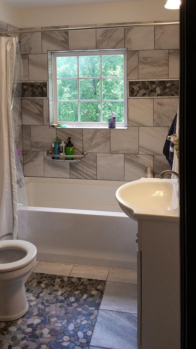 Custom tile work in small bathroom remodel