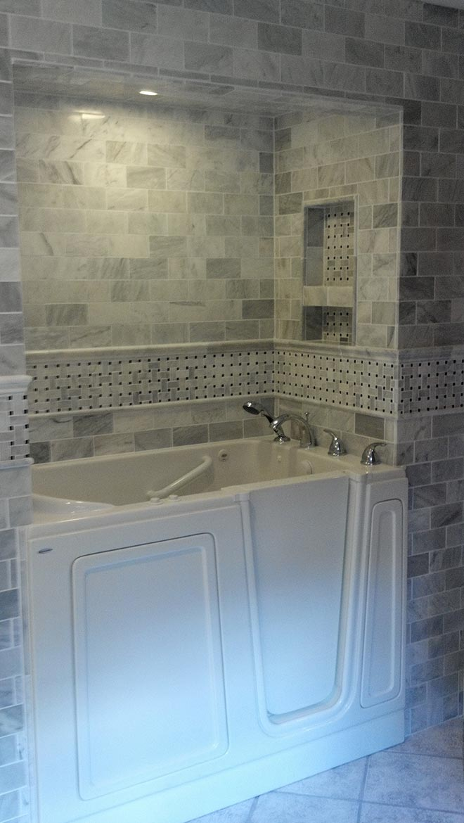 Walk-in tub with complete tile surround