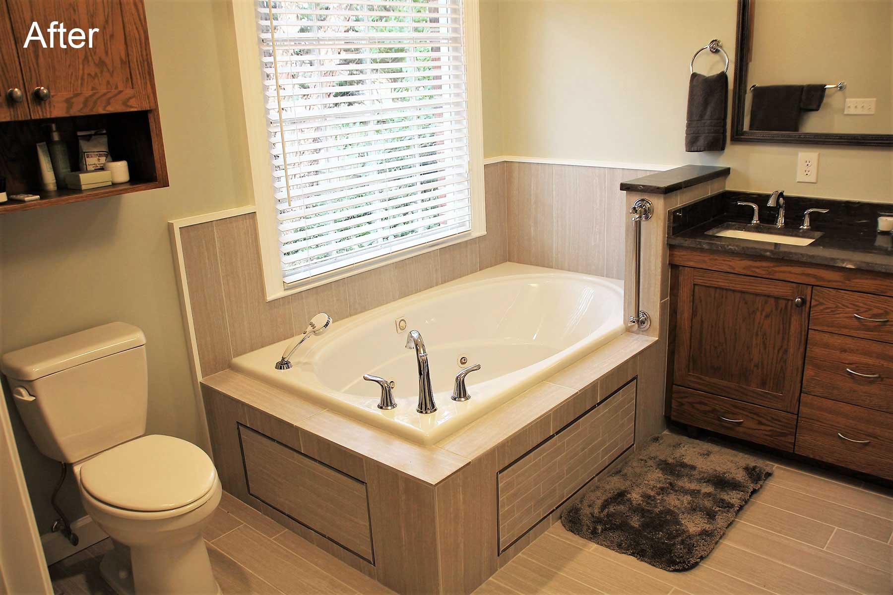 Freestanding tub after remodel includes natural tile and safety grab bar