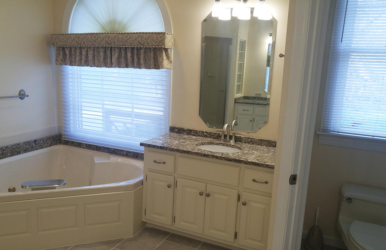 Second vanity and whirlpool tub