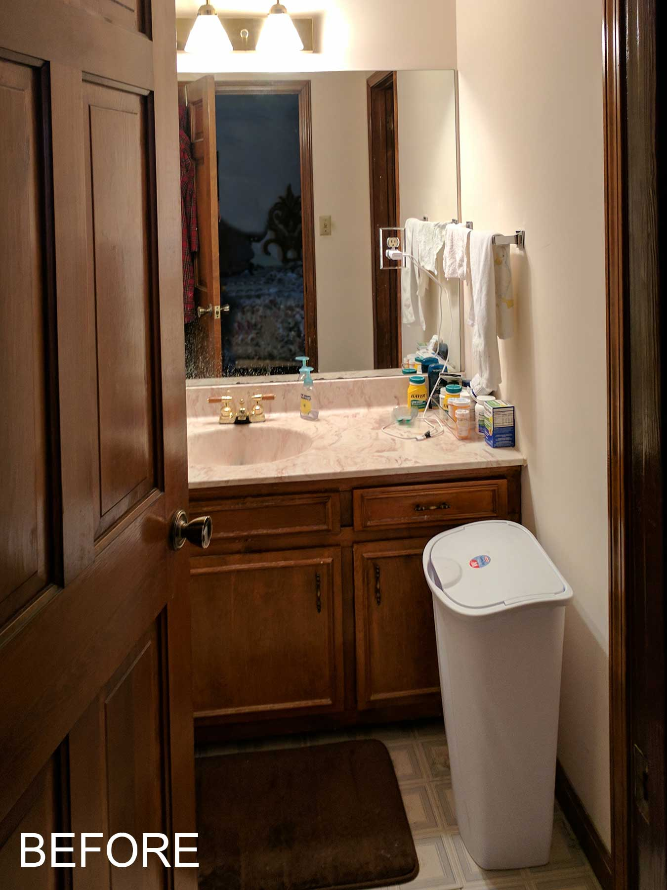 View of bathroom vanity before remodeling