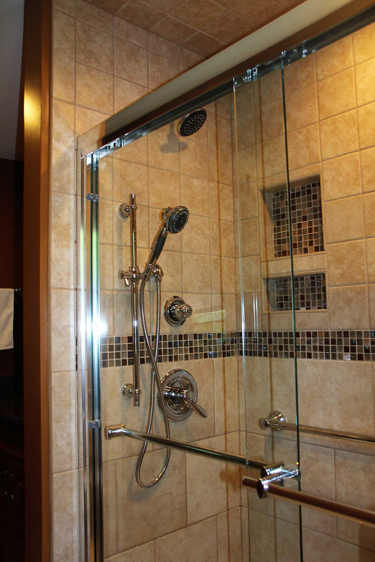 View of shower with built in nooks after remodeling
