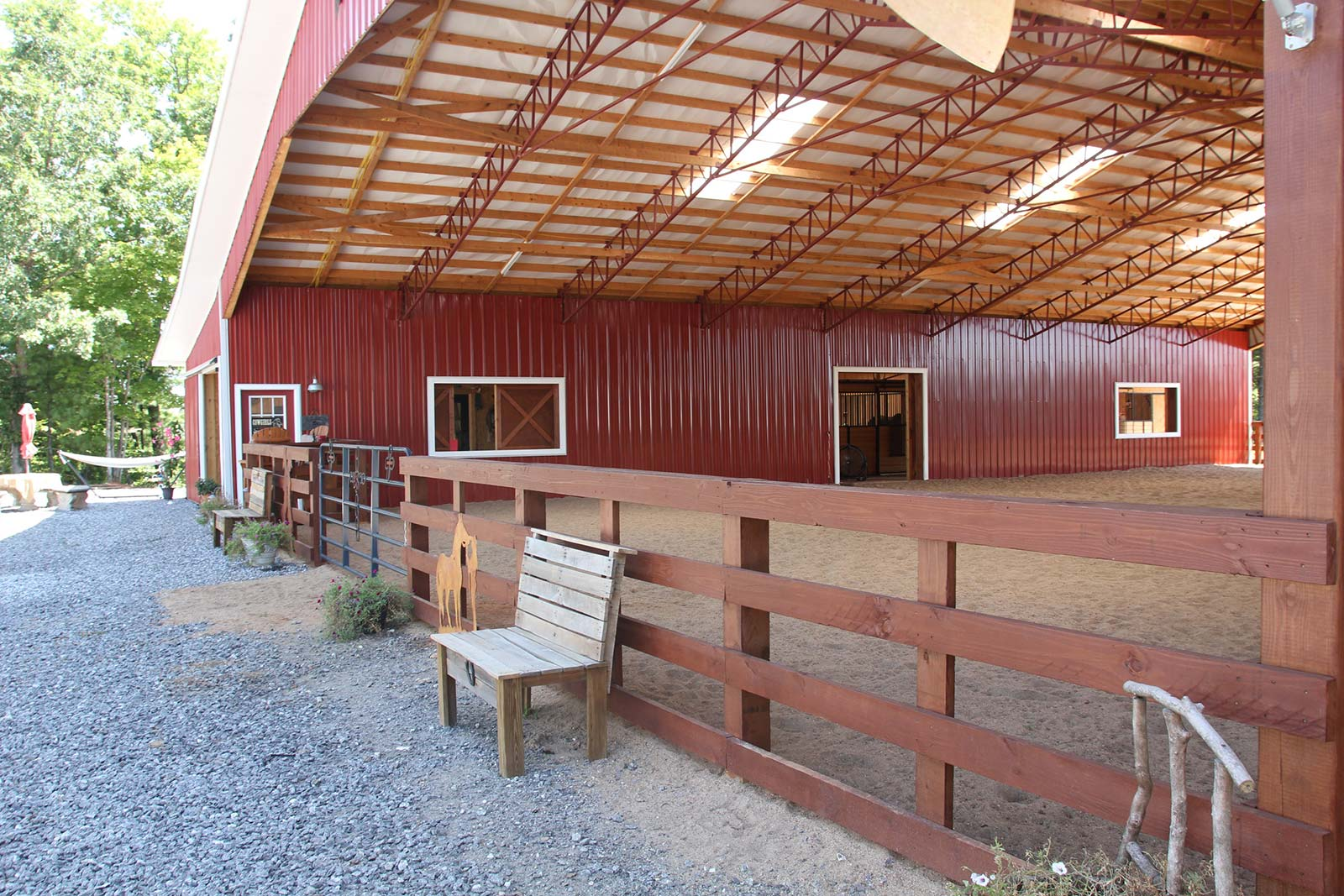 Riding arena incorporated into equestrian facility