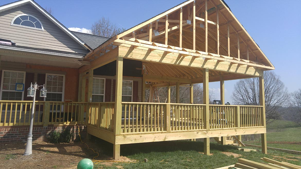 Large screened porch being constructed